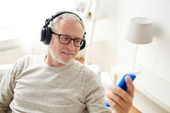 happy-senior-man-smartphone-headphones-technology-people-lifestyle-distance-learning-concept-listening-to-music-79316615